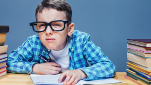 kid squinting in classroom at school
